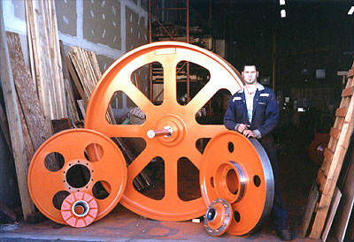 "7' Dia. x 12"" Face Top Bandwheel with a pair of 44"" Dia. x 4 3/8"" Face Bandwheels c/w Hub"
